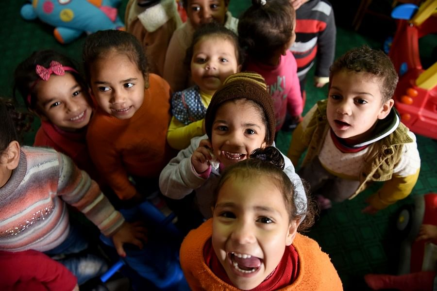 """Egyptian children play at the Banati Foundation shelter, a civil society organisation that works with street children, in the capital Cairo on February 16, 2017. For Egypt's government and civil society groups, tackling the growing problem of street children -- some from second- and even third-generation homeless families -- is proving difficult. According to the most recent ministry figures from a 2014 survey, Egypt has about 16,000 street children, said the spokesman for the """"Children Without Shelter"""" programme. / AFP PHOTO / MOHAMED EL-SHAHED"""