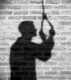 Shadow of sad man hanging suicide. light and shadow