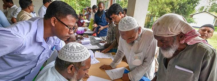 People check their names on the final draft of Assam's National Register of Citizens at a NRC Seva Kendra in Nagaon