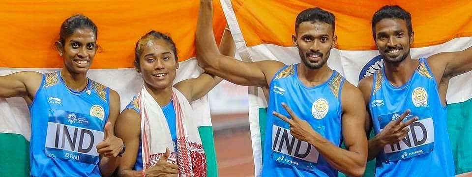 Sprinter Hima Das (second from left), along with other members of the Indian mixed 4x400m relay team that won a silver on Tuesday