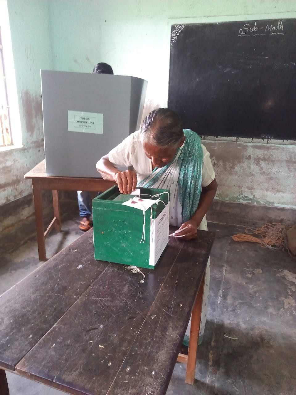 A woman casts her vote during the panchayat by-elections on Sunday