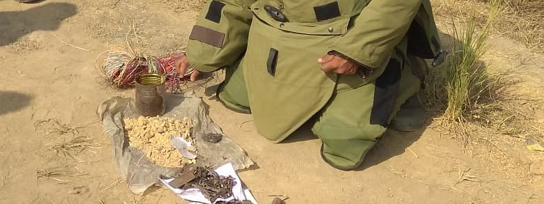 A bomb disposal squad member disposing of the IED in Thoubal district, Manipur