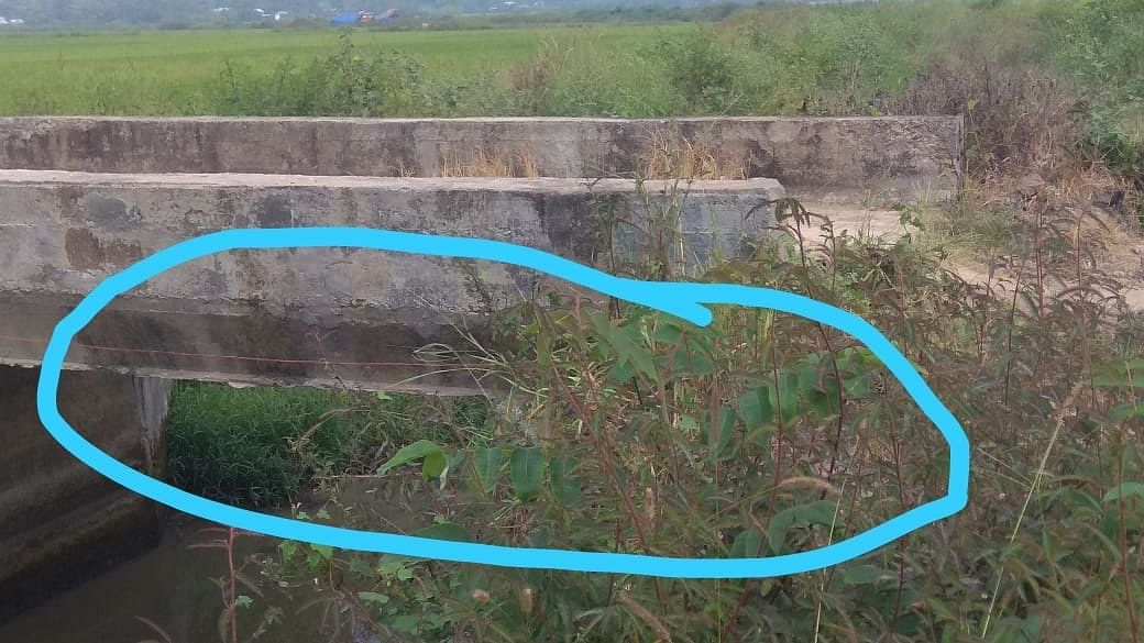 The spot near a culvert along the Imphal-Moreh highway where the IED was placed