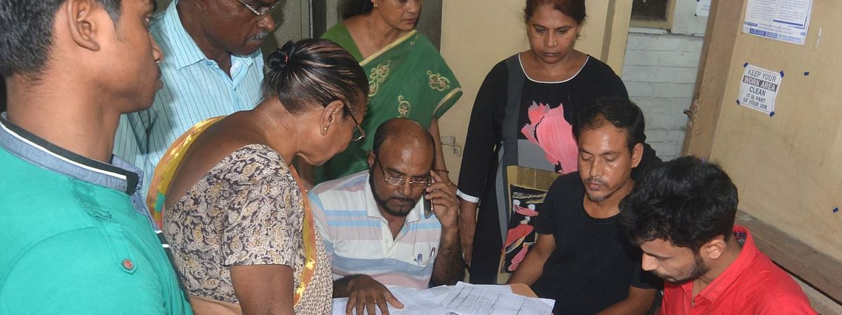 Applicants getting their documents verified at an NRC office in Assam