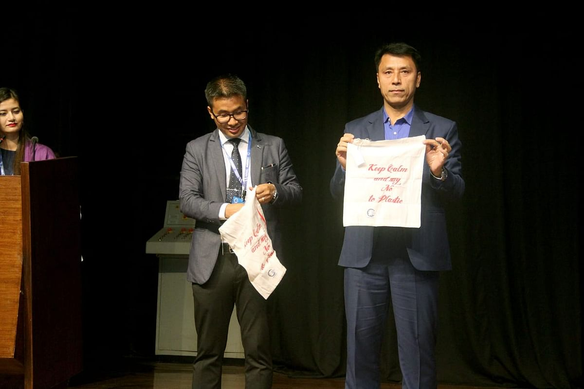 Manipur minister Thokchom Radheshyam launching the 'Eco Bag', a movement to fight plastic pollution, on the first day of the youth conclave in Imphal on Friday