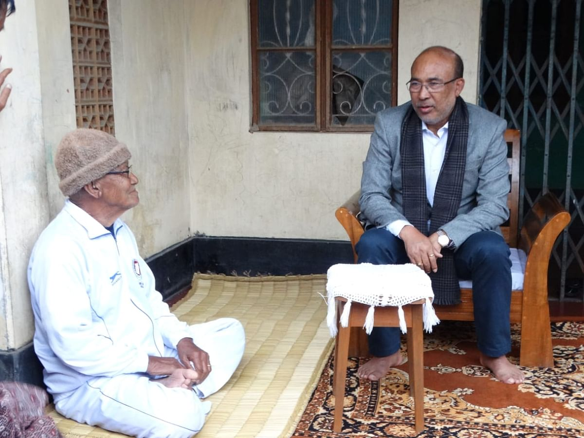 Manipur CM N Biren Singh (left) with newly appointed Hockey India president Gyanendro Ningombam