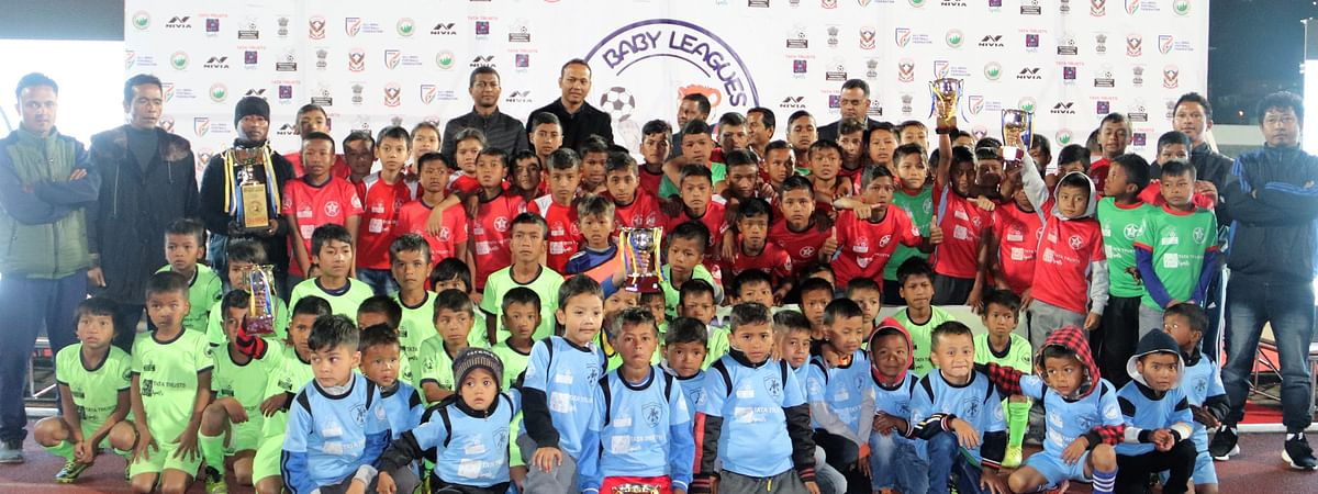 Participants during the final match of Meghalaya Baby League pose for a photograph