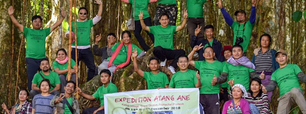 The group of adventure enthusiasts posing in front of Atang Ane, considered the largest tree of the state