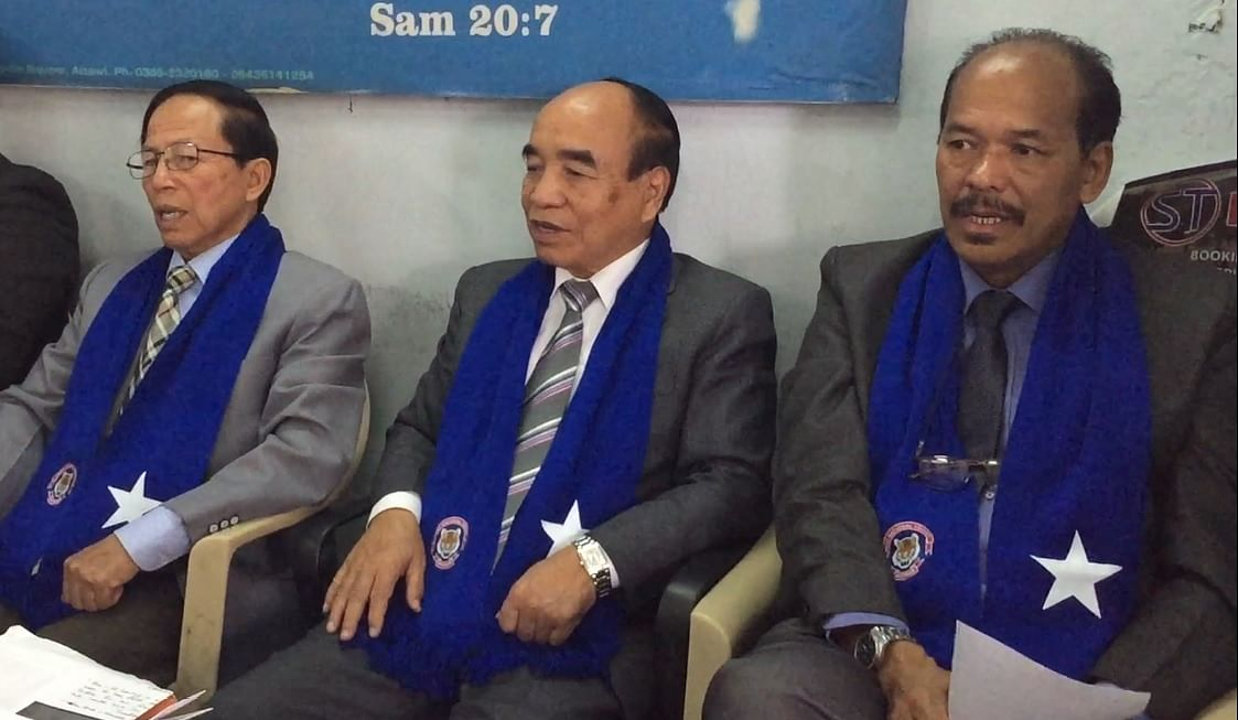 Mizoram CM Zoramthanga (centre) during an election campaign in the state