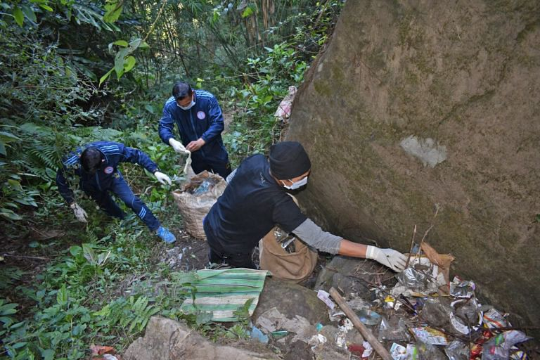 A group of trainee and expert mountaineers recovered four trucks of trash from a rock formation in Darjeeling, offering a glimpse into the problem of waste in mountain areas