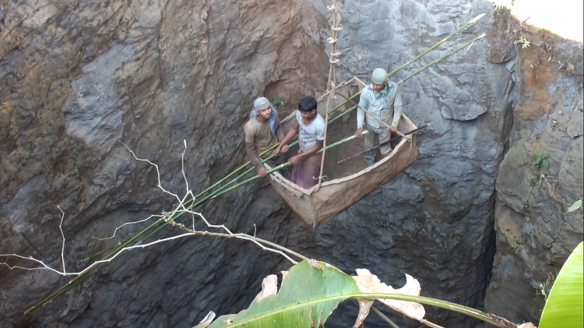 Labourers going inside a mine in Meghalaya