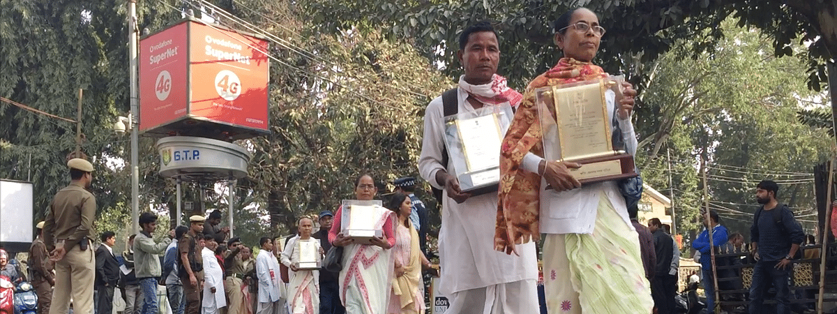Family members of martyrs' of Assam agitation on their way to the DC's office to return their awards in Guwahati
