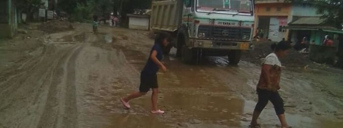 Flooded road of Naginimora town and its deplorable road condition