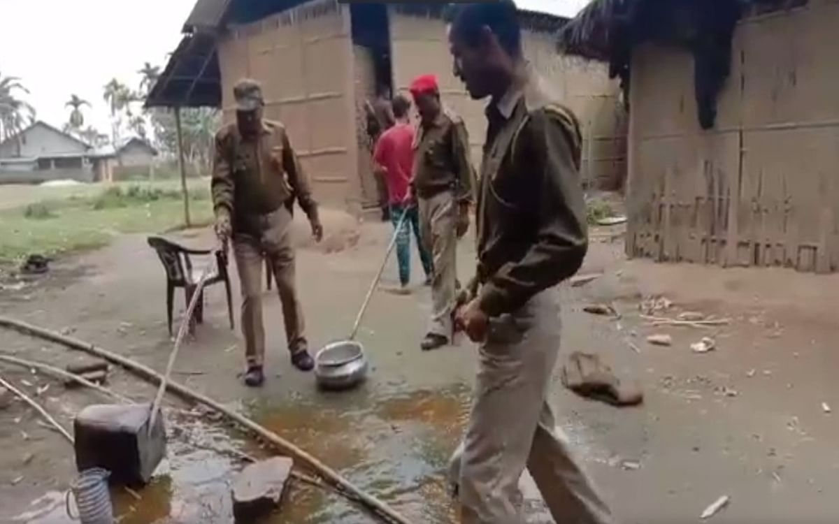 Police personnel destroying illicit liquor stocks in different parts of both the districts.