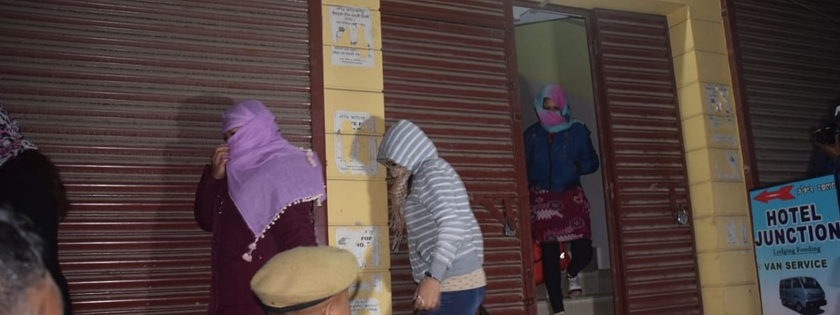 Alleged victims of trafficking being rescued by the Manipur police after a raid in a hotel
