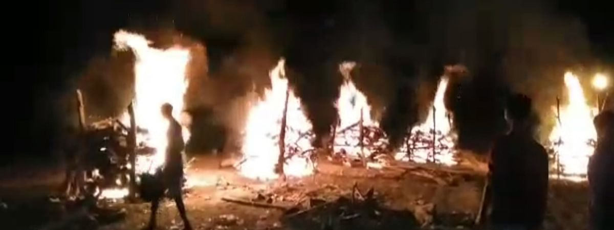 Burning pyres of the victims of the incident.