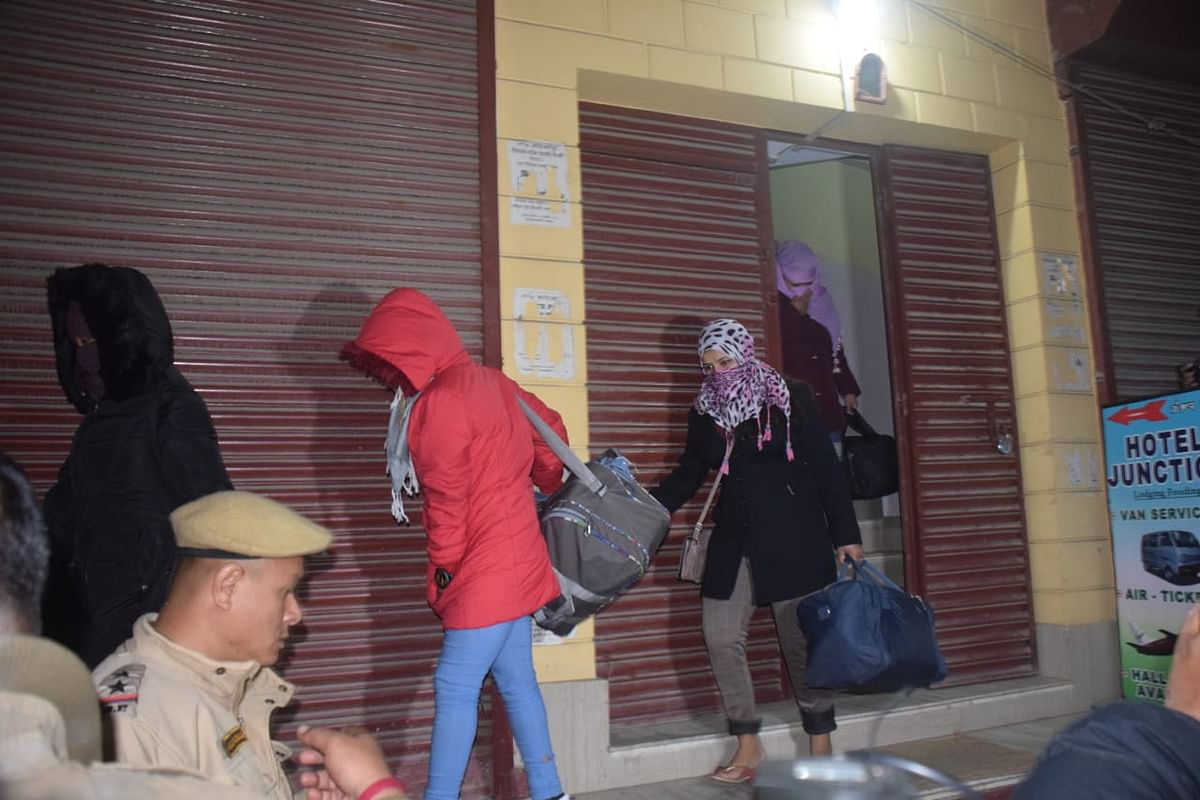 Trafficked girls being rescued by the Manipur police after a raid in a hotel