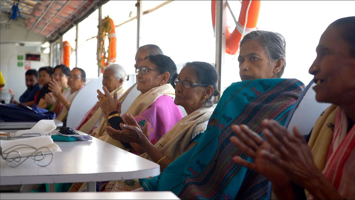 Inmates of Mother Old Age Home in Guwahati enjoying a live musical performance on board Alfresco Grand, a floating-cum-cruise restaurant
