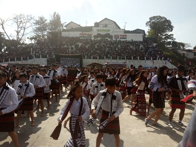 Boys and girls performing the Chawnglaizawn dance in Aizawl on Friday