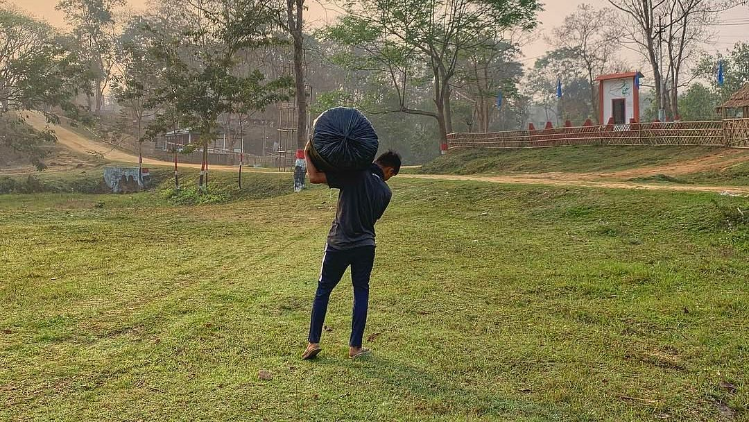 Raikom Enghi, 17, starts as early as 5 am every morning and covers a distance of about 6 km from his home in order to reach Taralangso in Assam's Karbi Anglong district