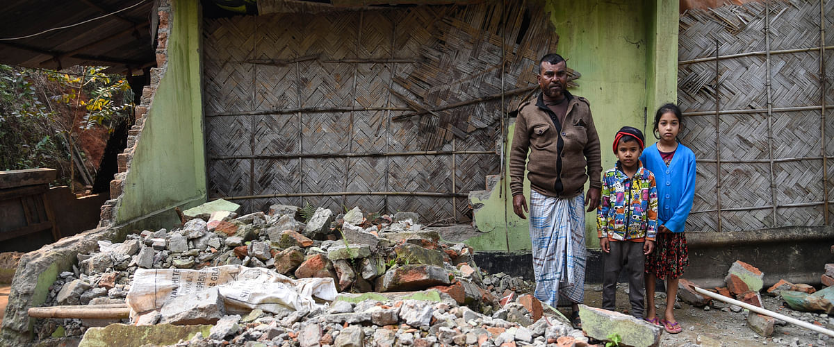 Abdul Hakim lives inside the debris with his two children at Yusuf Nagar in Kamrup district, Assam. His house was demolished on November 27, 2017 during the Amchang eviction drive. Up to 3,418 people of the 864 families living near the Amchang Wildlife Sanctuary have been sleeping under the open sky since then