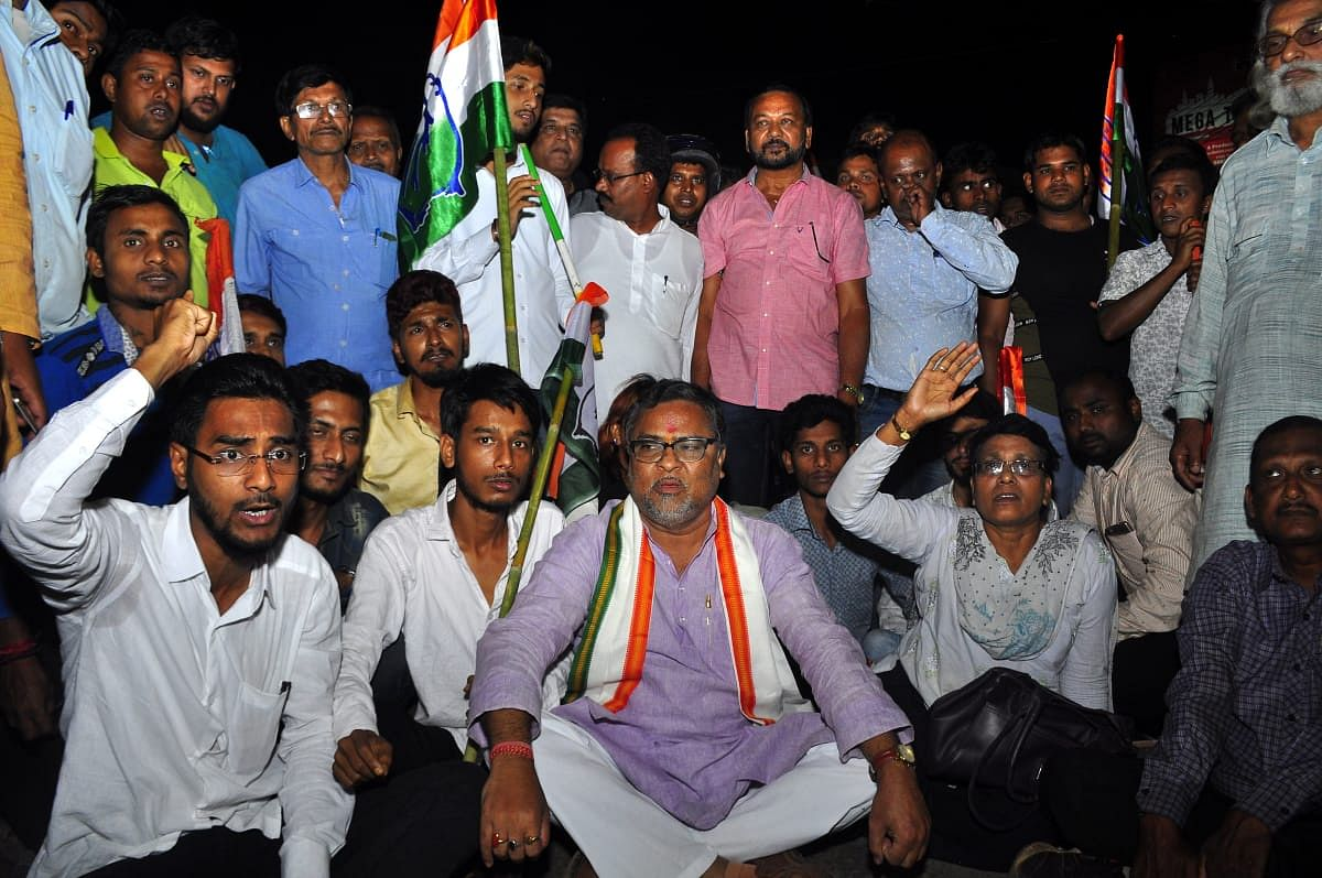 The West Tripura congress candidate, Subal Bhowmik, agitating in Agartala after being attacked in Phongbar, Sepahijala district during his poll campaign on Thursday