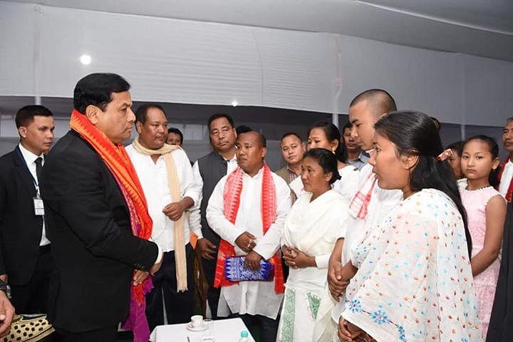 Chief minister Sarbananda Sonowal interacts with the family members of Maneswar Basumatary, who was killed along with 30 other CRPF personnel in a terror attack at Pulwama, Jammu & Kashmir on February 14
