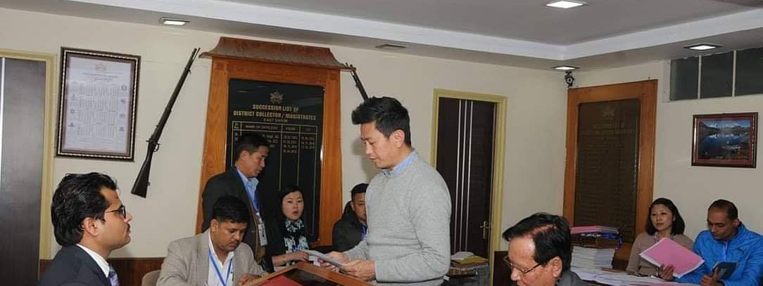 Bhaichung Bhutia filing his nomination at the office of Returning Officer Kapil Meena at District Administrative Premises, Sichey