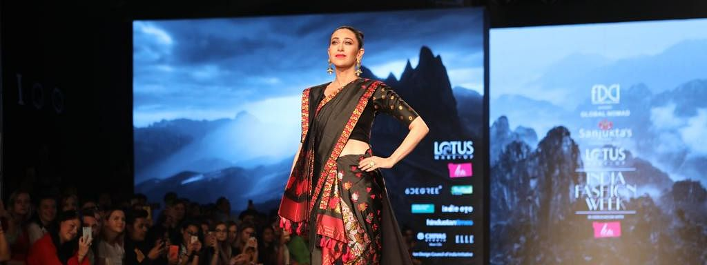 Actress Karisma Kapoor flaunts 'mekhela chador', a traditional Assamese attire, at the Lotus Makeup India Fashion Week (LMIFW) in New Delhi on Thursday
