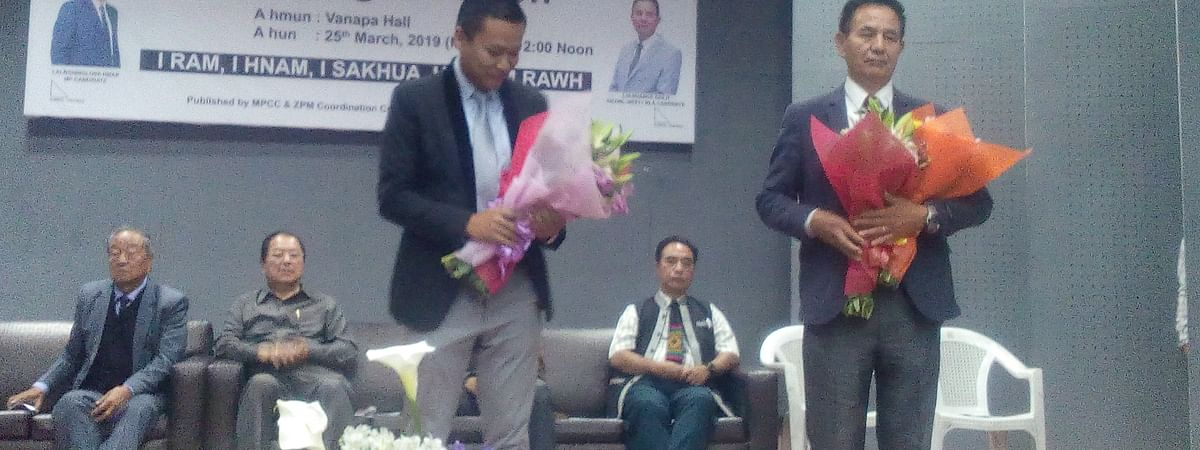 Lalnghinglova Hmar (left) and Lalbuanga Sailo being felicitated during campaign kickoff in AIzawl on Monday