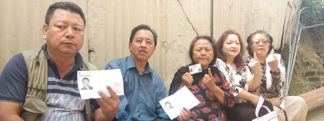 Voters wait for their turn at a polling station in Mizoram on Thursday
