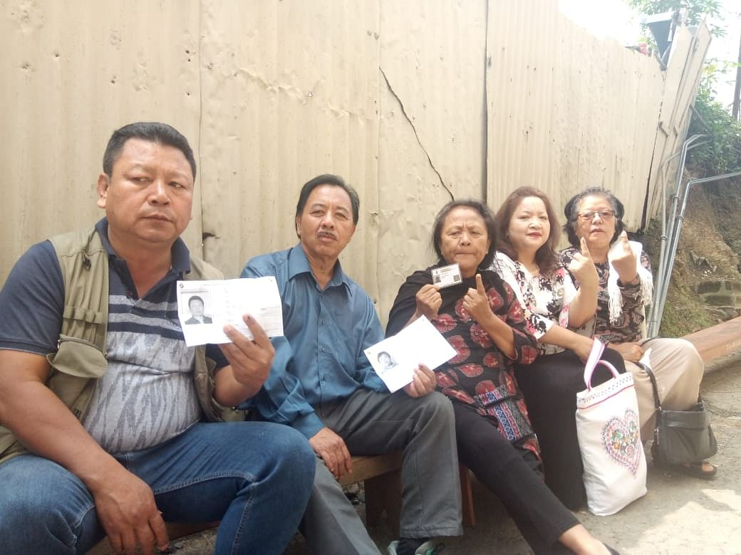 Voters waiting for their turn at a polling station in Mizoram on Thursday