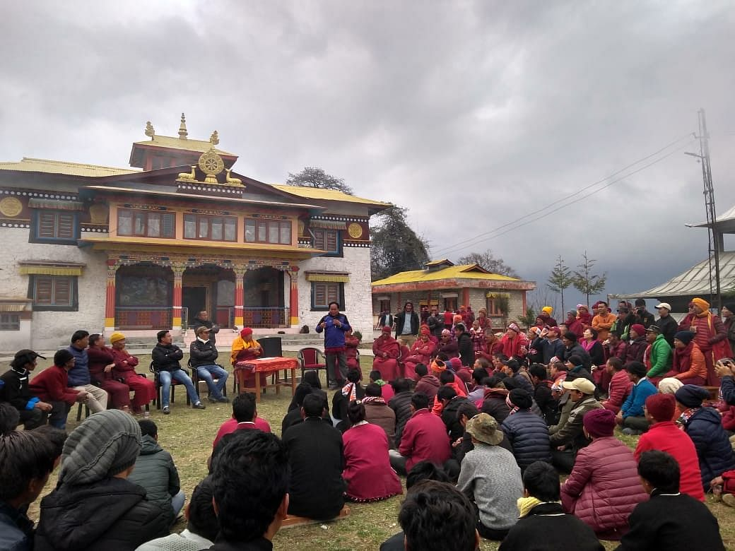 Monks and nuns from different areas of Mukto constituency assemble during the campaign trail of Congress candidate Geshe Thupten Khunpen at a nunnery near Lhau village