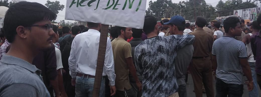 Students of Tripura University protesting in NH-7 over the death of a Group-D staff