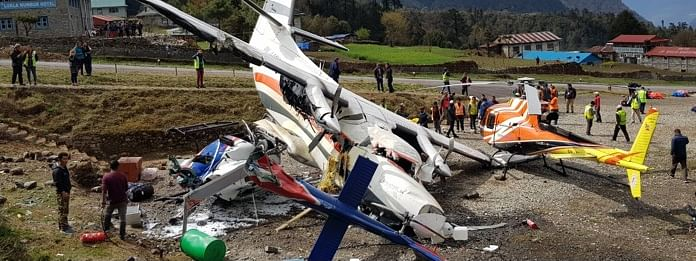 The crash of a small passenger plane into a parked helicopter at Nepal Tenzing Hillary Airport claimed at three people, and injured four others on Sunday, said, officials