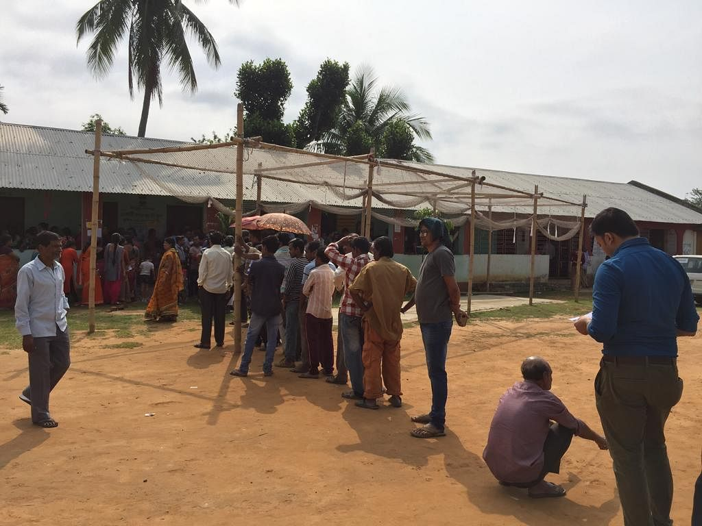 Voters queue up to cast their votes in Tripura West constituency during the first phase on April 11