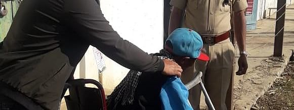 A differently-abled voter being assisted in Kohima, Nagaland