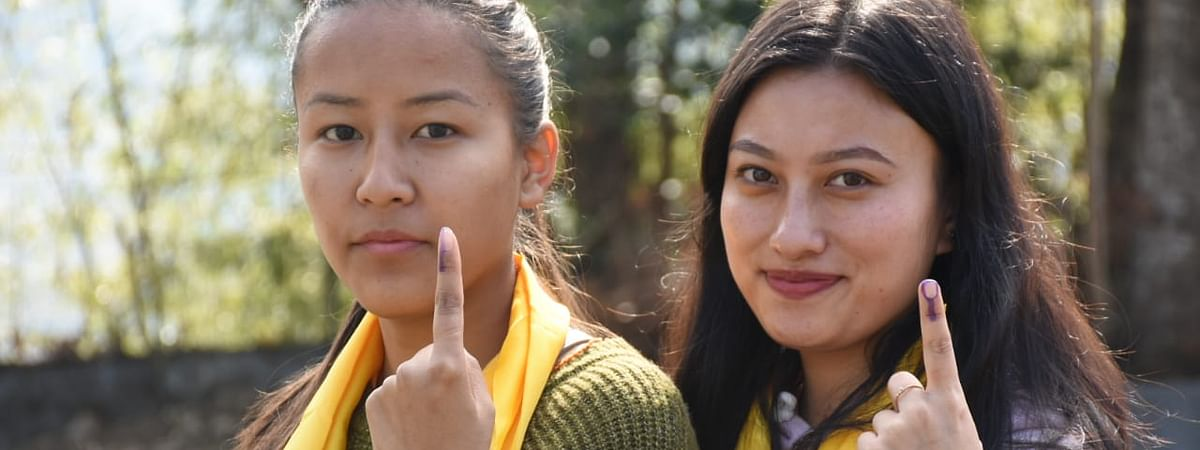 First-time voters show their inked finger in South Sikkim