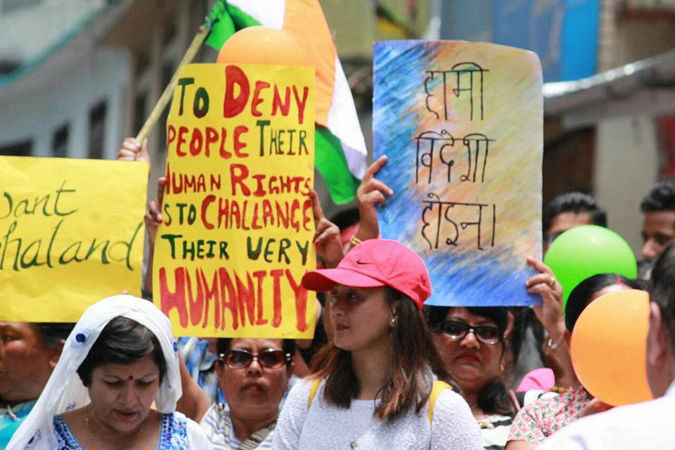 Darjeeling residents take part in a protest against, what they call, linguistic imperialism