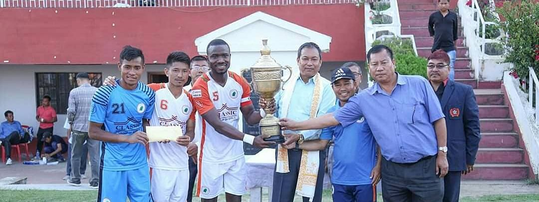 NEROCA FC players with the 12th Manipur State League trophy