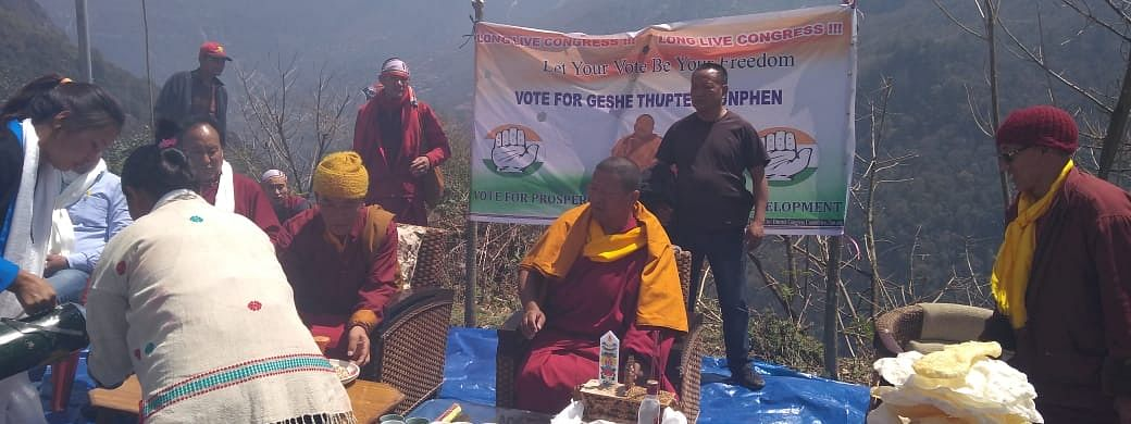 Congress candidate Geshe Thupten Kunphen being welcomed Lhau residents outside the village
