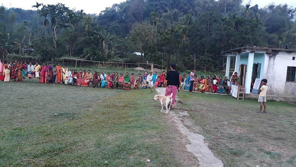 Women voters sit on benches at remote polling station in Meghalaya on Thursday