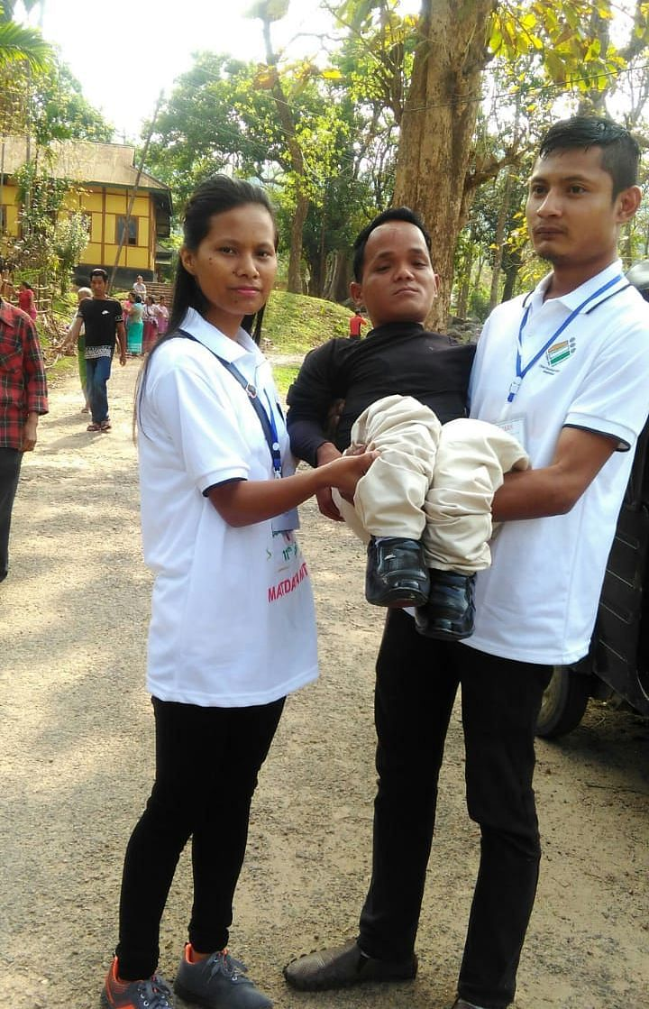A differently-abled voter being assisted by 'Matdata Mitras' in Meghalaya