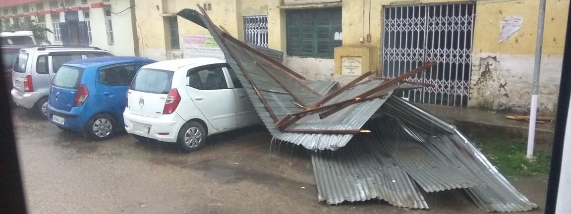 A thunderstorm accompanied with gusty wind and lightening left a trail of destruction in Manipur on Monday