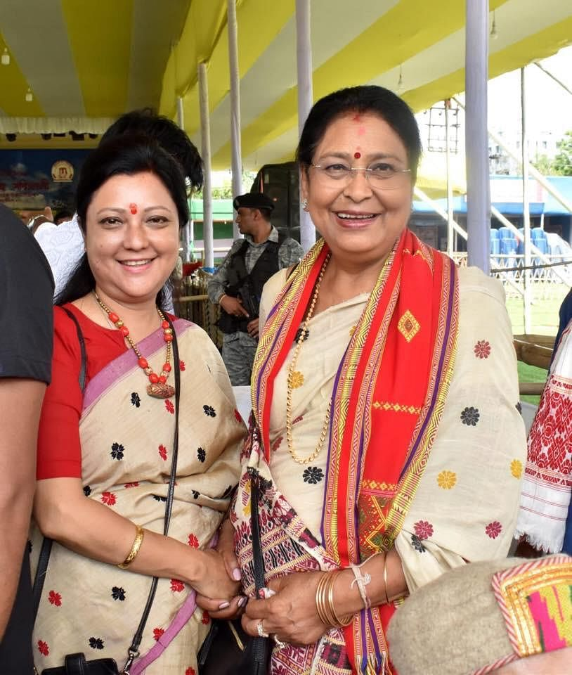 Congress candidate Bobbeeta Sharma (left) and BJP's Queen Oja were seen together at a Bihu event in Guwahati on Sunday