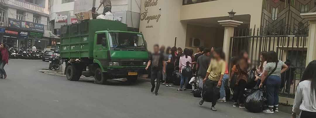 Residents stand in queue to dispose of their garbage in Aizawl, Mizoram