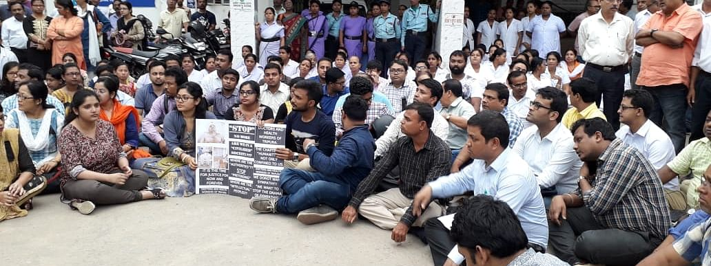 Members of All Tripura Government Doctors' Association (ATGDA) and Indian Medical Association (IMA) protesting in front of IGM hospital on Thursday