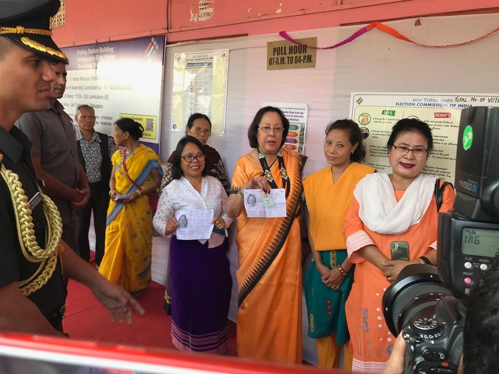 Manipur governor Najma Heptulla standing in a queue to cast her vote