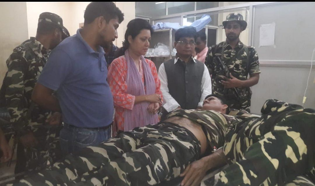 Bobbeeta Sharma, the Congress candidate for the Gauhati Lok Sabha constituency, talking to one of the injured SSB jawans at Gauhati Medical College & Hospital in Guwahati on Wednesday night