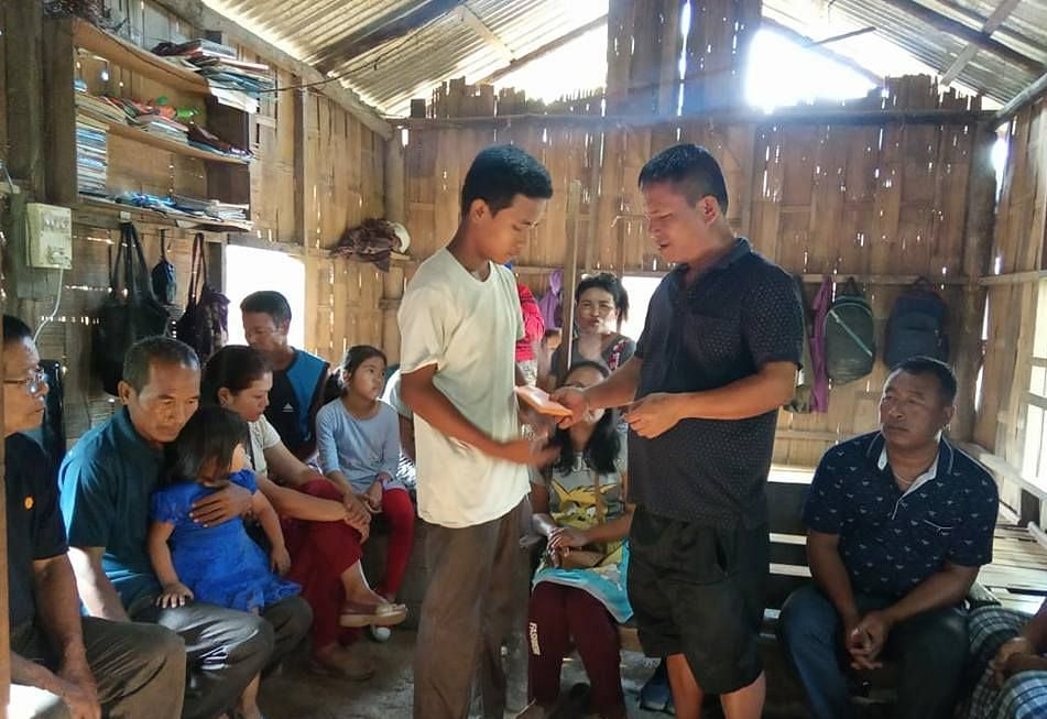 15-year-old Given Lawmnakima Thiak (in white T-shirt) being congratulated by neighbours in Mizoram's Kolasib district after he earned a distinction in the Class X exams